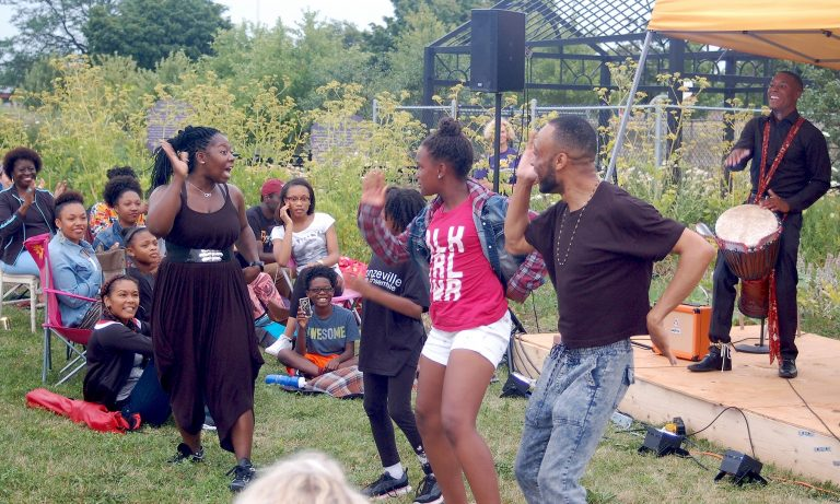 Members of the Ko-Thi Dance Company invite audience members to participate in their performance at Alice's Garden. Photo by Andrea Waxman.
