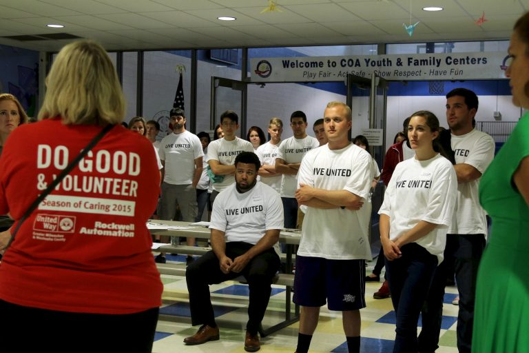 United Way Vice President of Volunteer Engagement Jayne Thoma (red t-shirt) introduces the day's events to the 70 intern volunteers at COA Goldin Center. Photo by Amelia Jones.