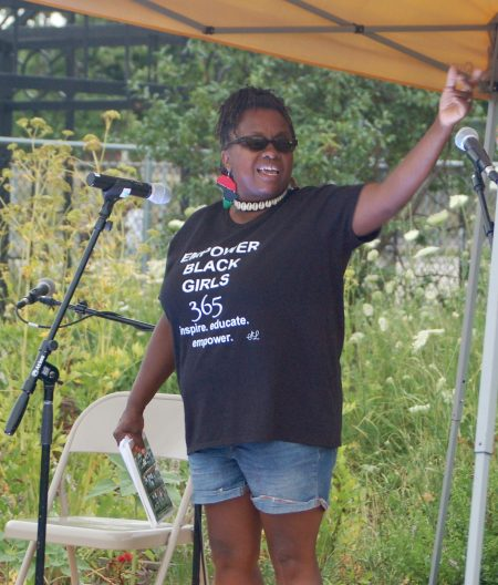 Venice Williams speaks at a recent Black Lives Matter gathering at Alice's Garden. Photo by Andrea Waxman.