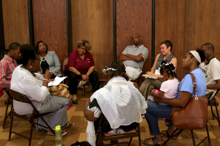 Attendees share stories in discussion circles during a recent listening session on police-community relations. Photo by Jabril Faraj.