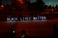"""Black Lives Matter"" was visible in illuminated letters from I-43 northbound. Photo by Jabril Faraj."