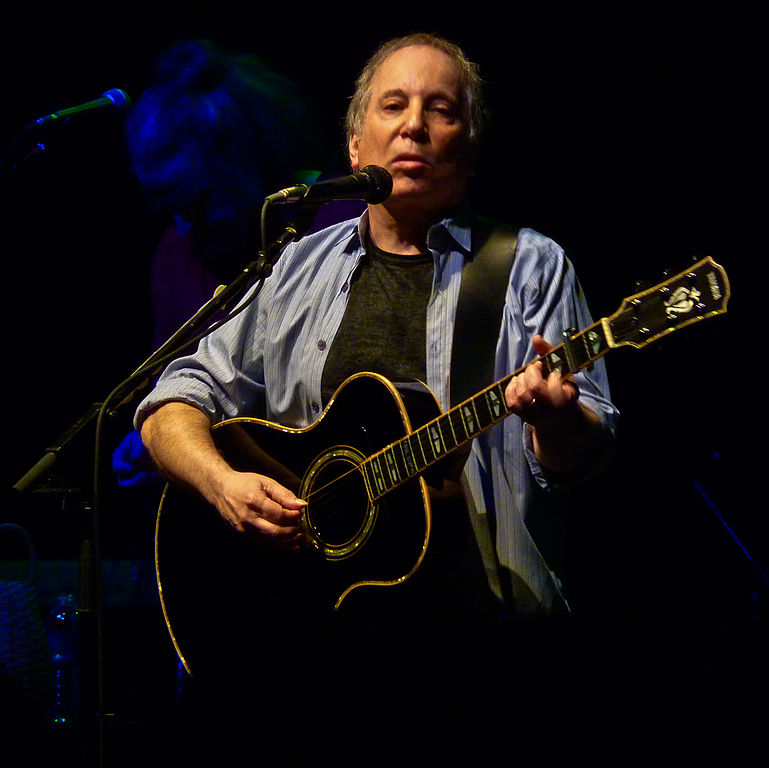 Paul Simon playing at the 9:30 Club in Washington, D.C. Photo by Matthew Straubmuller (imatty35) (http://flickr.com/photos/imatty35/5766935439/) [CC BY 2.0 (http://creativecommons.org/licenses/by/2.0)], via Wikimedia Commons.