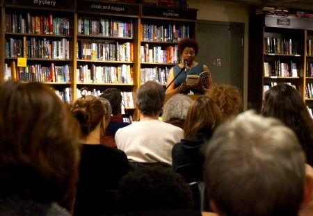 """Dasha Kelly reads from her novel, """"Almost Crimson,"""" at Boswell Book Co. last year. Photo by Adam Carr."""