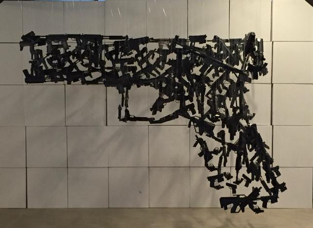 Hanging sculpture of guns from another angle. Photo by Craig Mastantuono.