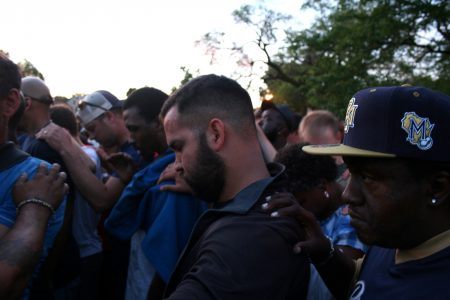 A diverse group of Milwaukee residents gathered near Sherman Park to pray for healing. Photo by Jabril Faraj.