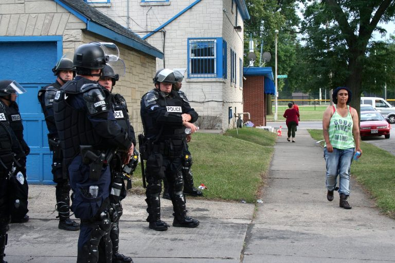 The National Guard was activated, Milwaukee County Sheriffs closed Sherman Park and police were heavily armed and armored after two nights of violent demonstrations. Photo by Jabril Faraj.