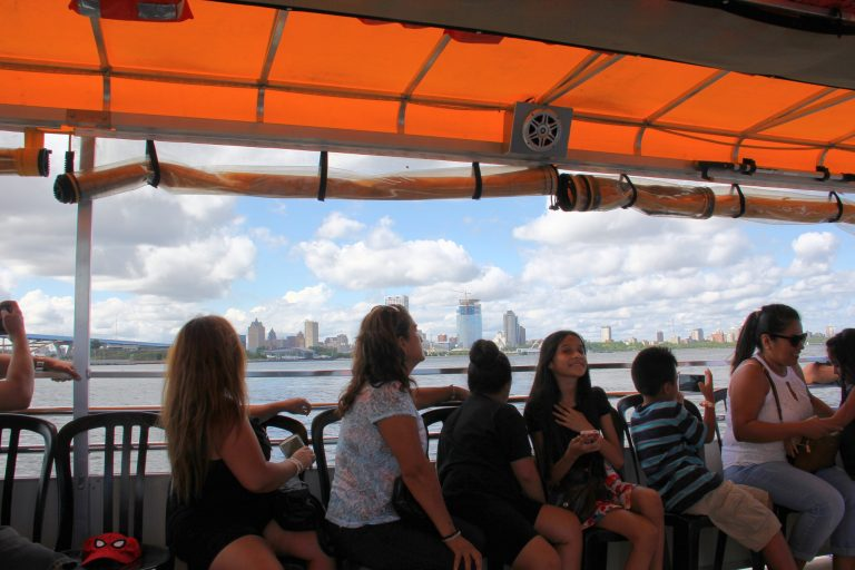 Passengers admire the Milwaukee skyline on a Harbor District Inc. boat tour. Photo by Rebecca Carballo.