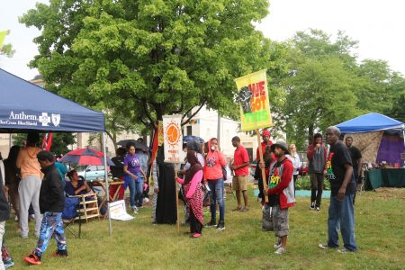 Community members gathered at the Peace Park & Garden after the march, where resource booths were set up. Photo by Amelia Jones.