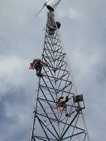 Climbing up a  wind turbine. Photo courtesy of  the Midwest Renewable Energy Association.