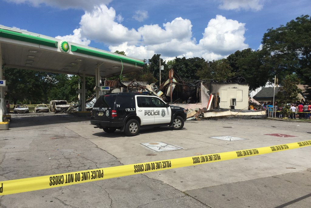 Gas station at Sherman and Burleigh was set on fire. Photo by Jeramey Jannene.