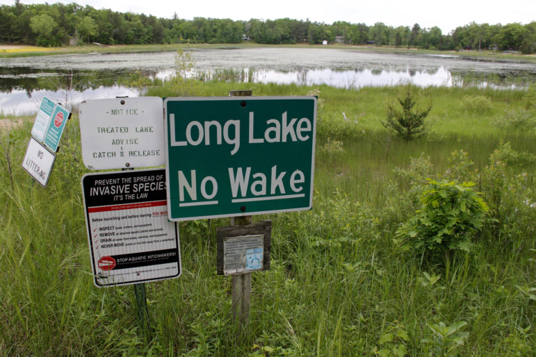The boat launch at Long Lake, near Plainfield, Wis., no longer reaches the water. In Wisconsin's Central Sands, some lakes and streams have lowered or dried up in recent years as the number of high-capacity wells has mushroomed, largely for irrigation. Concern over drawdown has become a big issue in the 72nd Assembly District race between Republican incumbent Scott Krug and his Democratic opponents, David Gorski and Russ Brown. Photo by Kate Golden Wisconsin Center for Investigative Journalism.