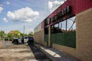 A Milwaukee Police Department SUV sits in front of the heavily damaged O'Reilly Auto Parts. Photo by Devante' Coleman.