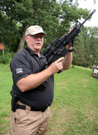 Curt La Haise is a shooting instructor, former police officer and a National Rifle Association member, seen here at his shooting range in Deerfield, Wis. La Haise is the owner of Guardian Safety & Security Solutions, which provides self-defense training. He holds a semi-automatic AR-15 rifle. Taken on July 30, 2016. Photo by Alexandra Arriaga of the Wisconsin Center for Investigative Journalism.