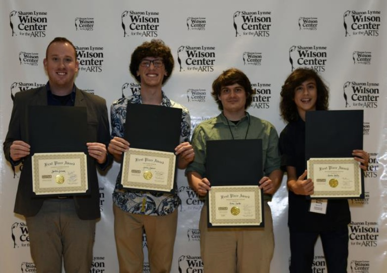 L-R: Steven Lerman (1st place winner, Classical), Jordan Rattner (1st place winner, Jazz), Brian Burke (1st place winner, Fingerstyle), and Andre Reilly (1st place winner, Rock/Blues).  Photo courtesy of the Sharon Lynne Wilson Center for the Arts.