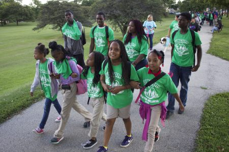 A group of children lead the UNCOM Walk for Wellness to support healthier living, in September 2015. Photo by Emmy A. Yates.
