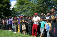 Black men and boys lock arms at the event. Photo by Jabril Faraj.