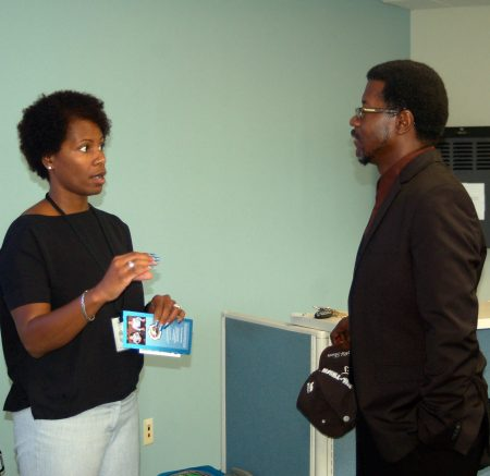 Milwaukee Police Department recruiter Katrina Warren discusses employment opportunities with Daniel Cotton. Photo by Naomi Waxman.
