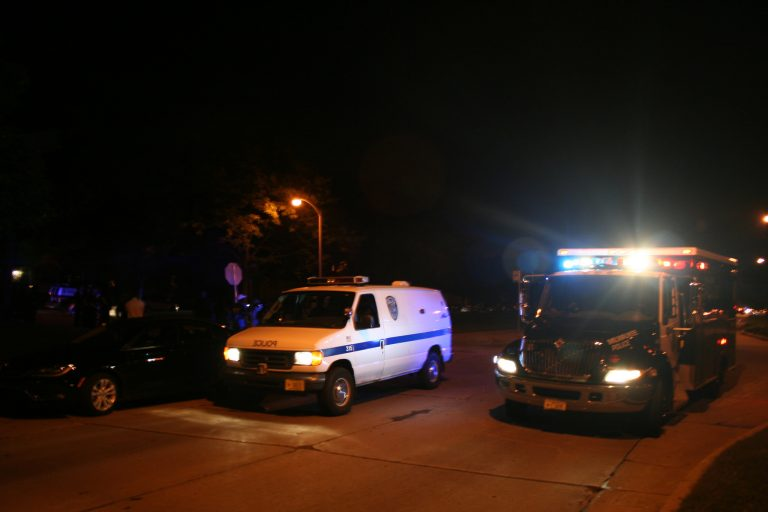 More than 40 officers and six police vehicles filled the intersection of Sherman Boulevard and W. Auer Avenue after 9:30 p.m. Tuesday night. Photo by Jabril Faraj.