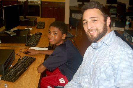 Ben Juarez (right) helps eighth-grader Allen De Windt with his project. Photo by Edgar Mendez.