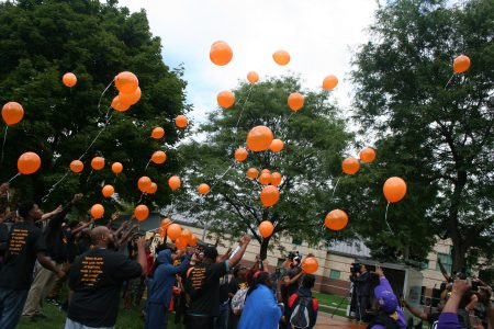 Attendees release balloons in a tribute to Eric Von, the iconic Milwaukee media personality who recently died unexpectedly. Photo by Jabril Faraj.