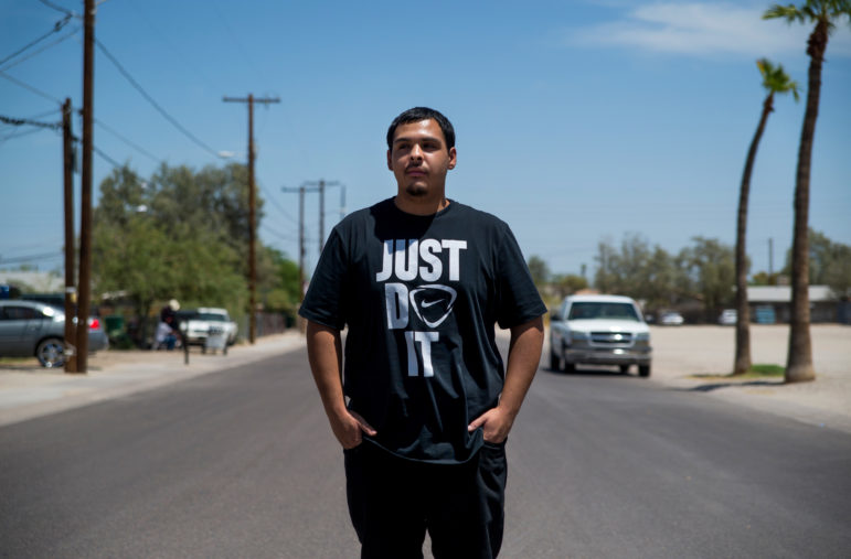 David Castorena, 24, of Chandler, Ariz., stands in the street of a small, largely-Latino community of Guadalupe where he attends church. Castorena said he does not plan to vote in the upcoming November Election because he thinks that Donald Trump will win either way. Photo by Roman Knertser of News21.