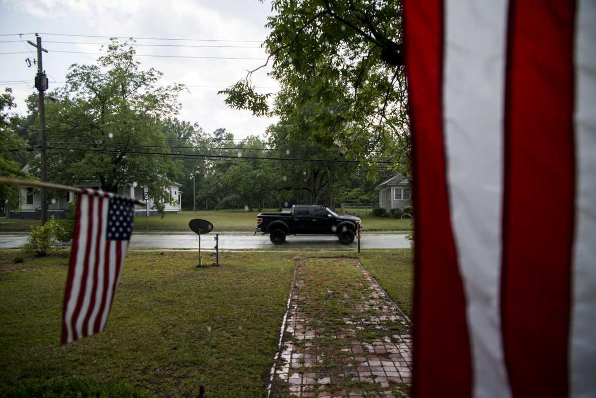 Residents in Sparta, Georgia, display American flags from their front porch on July 3, 2016. There have been 114 allegations of fraud investigated by the Georgia secretary of state since 2012. None of them involve voter impersonation, which is the type of fraud that voter ID laws are intended to prevent. Photo by Roman Knertser of News21.