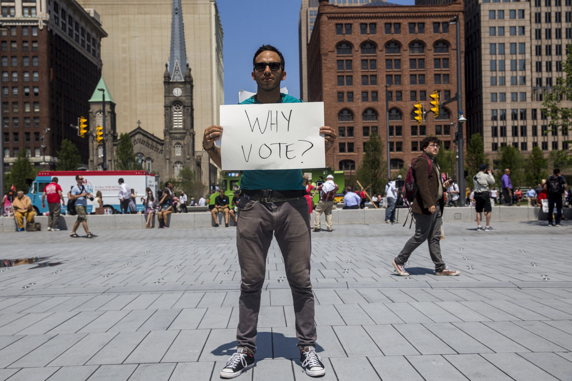 Oskar Mosco, 35, traveled from Santa Barbara, Calif., to protest in front of the Republican National Convention in Cleveland in July. Voters in 20 states, including Wisconsin, will face additional requirements and restrictions to vote, passed since the last presidential election in 2012, including presenting specific forms of identification at the polls. Photo by Emily Mahoney of News21.