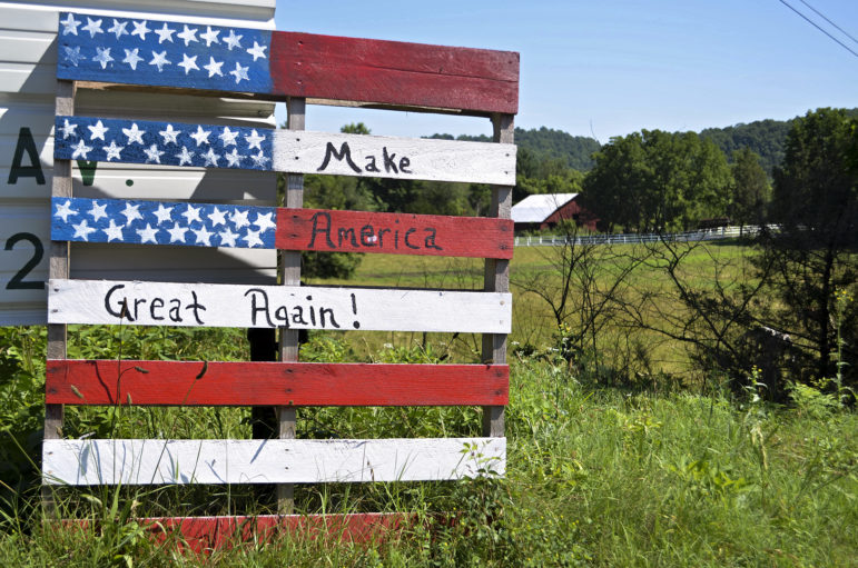 This handmade sign, made from a wooden pallet, declares support for Donald Trump in Clay County, Tenn. The area's poor economy is leading some of its traditionally Democratic residents to support the Republican billionaire businessman, who has promised to turn around the U.S. economy. Photo by Lian Bunny of News21.