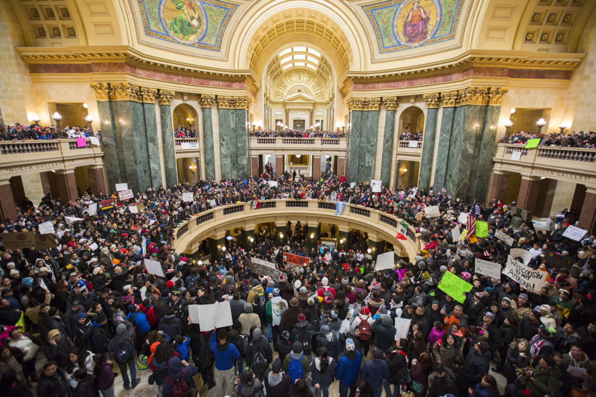 Latino protesters and supporters participate in the 'Dia Sin Latinos,' or Day Without Latinos, event inside the Capitol building to protest immigration bills on Feb. 18, 2016, Madison, Wis. The protest also was designed to highlight Hispanic's contribution to Wisconsin's economy. Photo by Saiyna Bashir of the Cap Times.