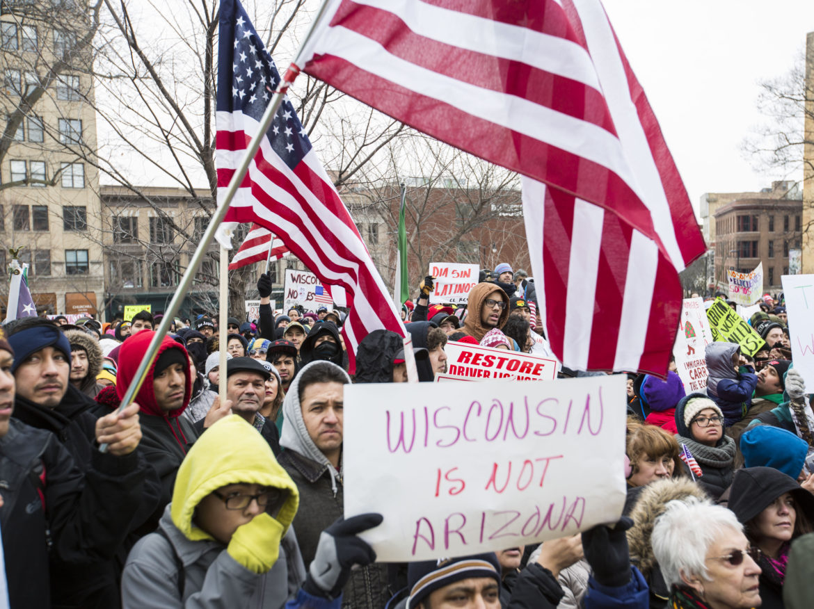 Thousands of Latino protesters and supporters carry signs outside the Capitol building to protest immigration bills on Feb. 18, 2016, Madison, Wis. The number of Latinos in Wisconsin has grown rapidly in recent years, now accounting for about 6.4 percent of the population. Photo by Saiyna Bashir of the Cap Times.