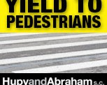 Hupy and Abraham, S.C. YIELD TO PEDESTRIANS!