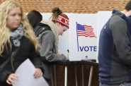 Eligible students cast their ballots for the presidential election and several state offices while voting at a polling place at Gordon Dining and Events Center at the University of Wisconsin-Madison on Nov. 6, 2012. Wisconsin's on-again off-again voter ID law will require students to present a photo ID to vote in the Nov. 8 election. Photo by Jeff Miller of the University of Wisconsin-Madison.
