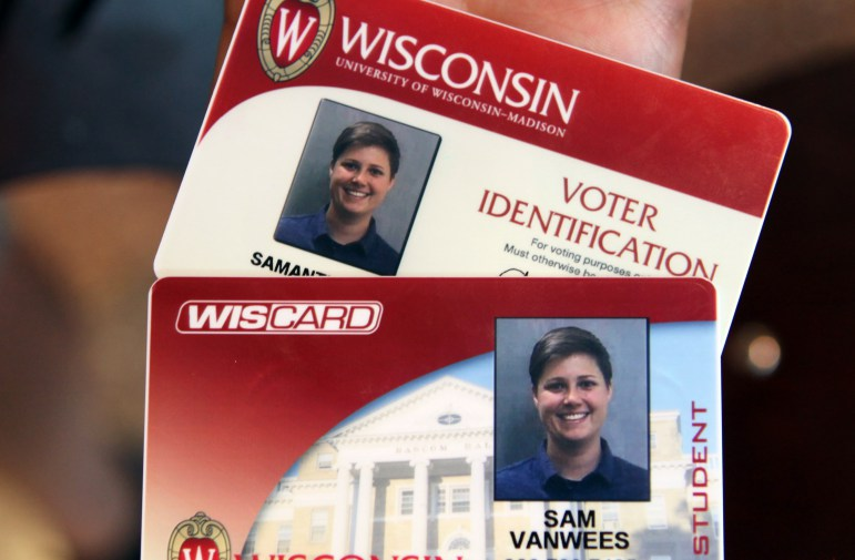 Sam VanWees from Des Plaines, Ill., says she was not aware she is eligible to vote in Wisconsin. She got her free voter ID card at Union South on the University of Wisconsin-Madison campus, along with her regular Wiscard student ID, on Aug. 30. Photo by Coburn Dukehart of the Wisconsin Center for Investigative Journalism.