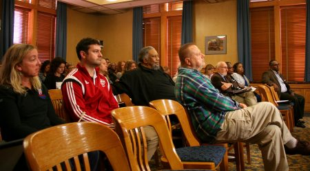 A crowd largely made up of individuals representing community organizations looks on during a Public Safety Committee hearing to solicit feedback on the its draft public safety plan. Photo by Jabril Faraj.