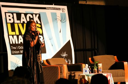 Moderator and UWM doctoral student Charmaine Lang announced Black Lives Matter speakers Alicia Garza and Patrisse Cullors. Photo by Allison Steines.