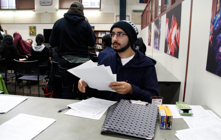 Ali Khan, 19, became more politically active in the past year in response to divisive rhetoric about Muslim Americans. Here he registers students at the Oct. 12, Black and Brown Vote event at the Multicultural Student Center at the University of Wisconsin-Madison. Photo by Alexandra Arriaga of the Wisconsin Center for Investigative Journalism.