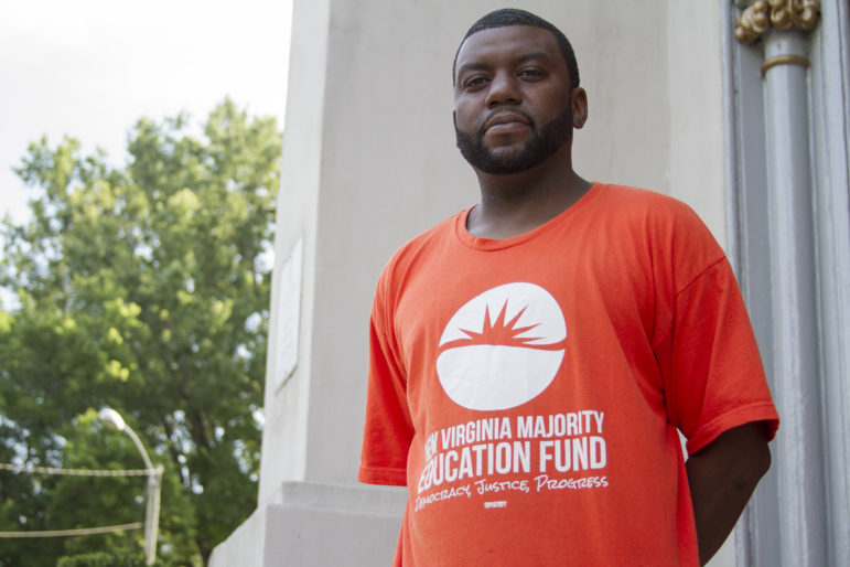 As a staff member with the New Virginia Majority Education Fund, Brandon Polly reaches out to felons living in and around Norfolk, helping them understand their rights and navigate the re-enfranchisement process. Photo by Marianna Hauglie of News21.