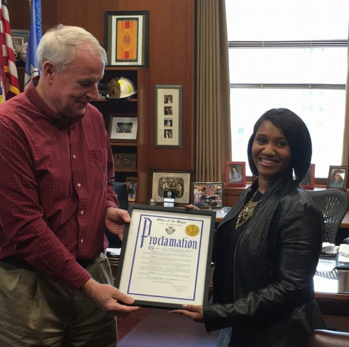 Ms. Hall receives an official proclamation from Mayor Tom Barrett in Milwaukee's City Hall. Photo courtesy of Signature Sweets.