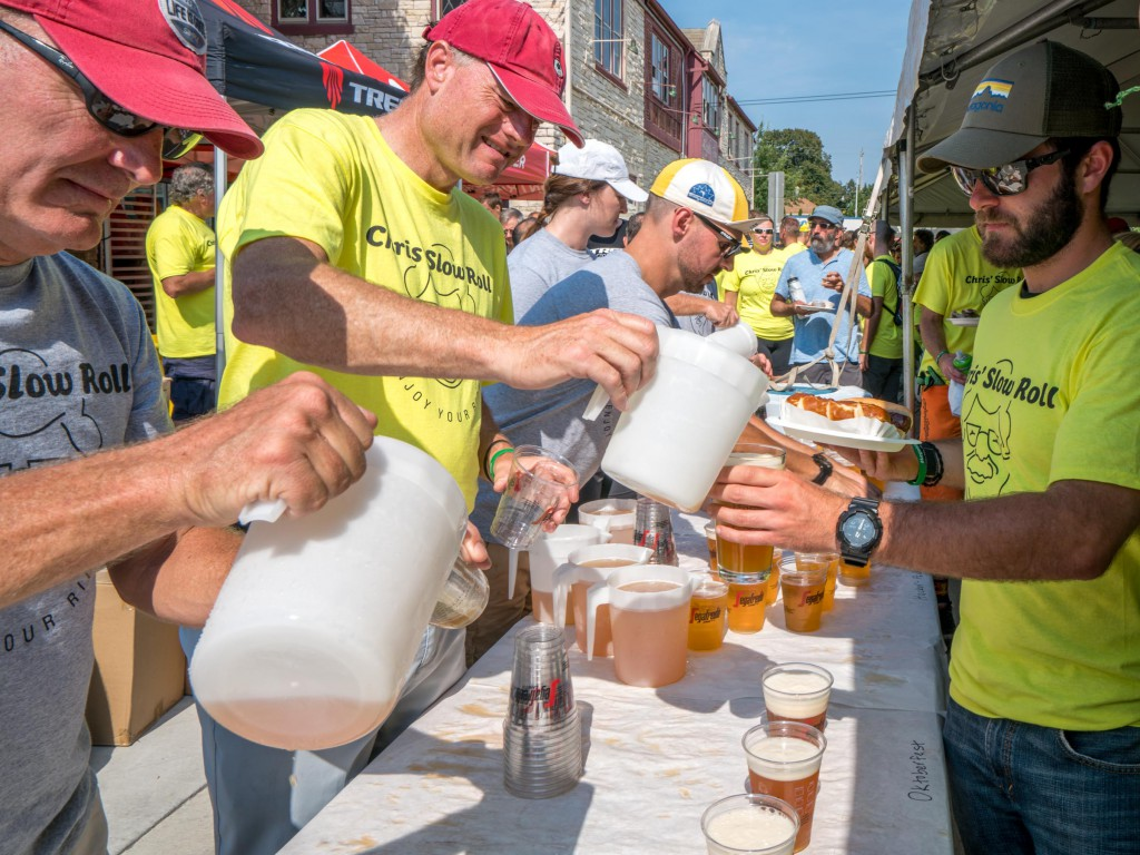 John Burke, president of Trek, helps pour the German beer with other Trek employees who volunteered their time.