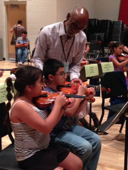 Tony working with Progressions students in a rehearsal. Photo courtesy of the Nonprofit Center of Milwaukee.