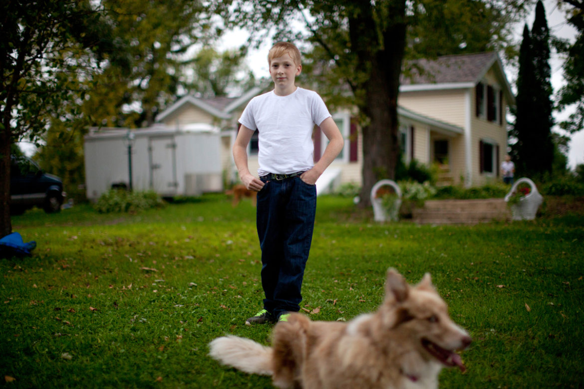"Jacob Reeves, pictured at home in Stoughton, was diagnosed in 2014 with juvenile dermatomyositis — a rare disease that his mother Dawn attributes to the high level of atrazine found in their well water. ""I only cried once,"" Dawn Reeves said, ""when they said he might not walk again."" Photo by Coburn Dukehart of the Wisconsin Center for Investigative Journalism."