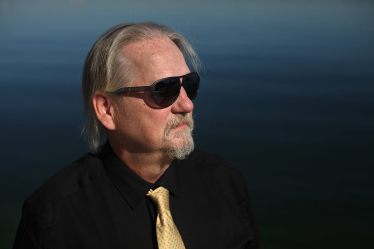 """Joseph Frey, who served more than 20 years of a felony conviction in Wisconsin, including eight years for a crime he did not commit, is photographed by Lake Mendota in Madison, Wis. Frey said it was """"life-changing"""" when could begin voting again in 2013. Photo by Coburn Dukehart of the Wisconsin Center for Investigative Journalism."""