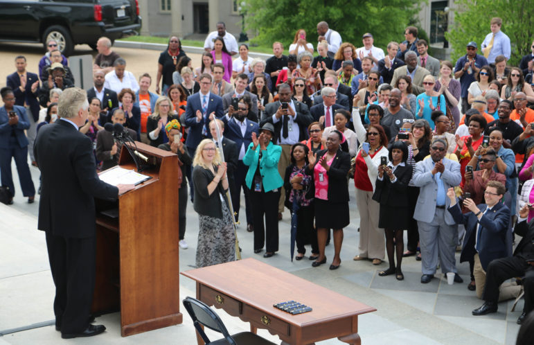 Virginia's Democratic Gov. Terry McAuliffe spoke to a gathered crowd in Richmond before signing a bill restoring voting rights to all Virginia felons on April 22, 2016. The bill was later struck down. Photo by Michaele White of the Governor's office via Flickr.