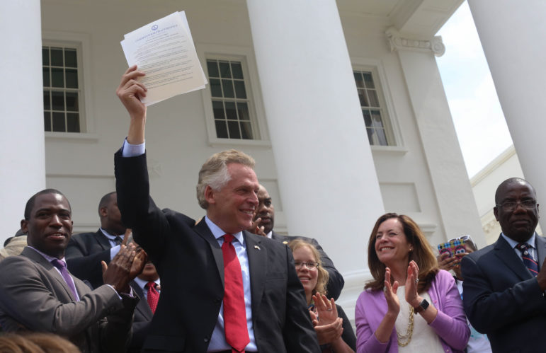 Virginia's Democratic Gov. Terry McAuliffe signed a bill restoring voting rights to all Virginia felons on April 22, 2016, in Richmond. The Virginia Supreme Court later struck it down. A News21 investigation found few efforts to expand voting rights to felons have been successful in recent years. Photo by Michaele White of the Governor's office via Flickr.
