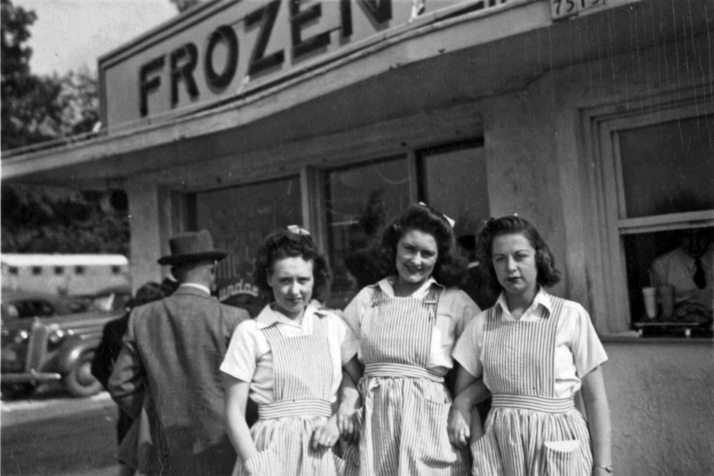 "Gilles Frozen Custard carhops, circa 1940, captioned on the back: ""Three girls from Iowa: Helen, Bonnie &amp; Ila."" Courtesy of Gilles Frozen Custard. Reprinted from <a href=""https://www.amazon.com/gp/product/1467118613/ref=as_li_tl?ie=UTF8&amp;tag=bobthekindotc-20&amp;camp=1789&amp;creative=9325&amp;linkCode=as2&amp;creativeASIN=1467118613&amp;linkId=d47ecca5ab6c1d8a594de9298f93695e"">Milwaukee Frozen Custard</a> by Kathleen McCann and Robert Tanzilo (The History Press, 2016)."