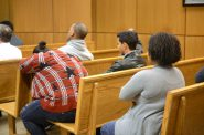 People wait for court proceedings to begin inside a Milwaukee Municipal courtroom. Photo by Sue Vliet.