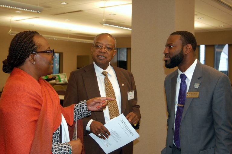 "Tri-Success Management Institute, Inc. President Ylonda Glover, WHEDA Executive Director Wyman Winston and Rep. David Bowen talk after the economic development forum, ""The 30th Street Corridor Like You've Never Seen It Before."" Photo by Naomi Waxman."