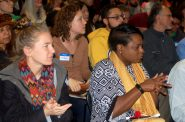 The audience listens attentively as panelists discuss the history of institutional racism in Milwaukee. Photo by Naomi Waxman.