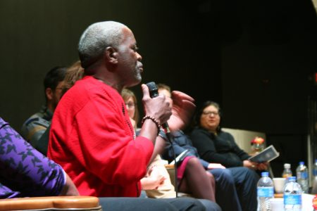 Andre Lee Ellis speaks from the stage during a panel discussion at a recent UEDA summit. Photo by Jabril Faraj.