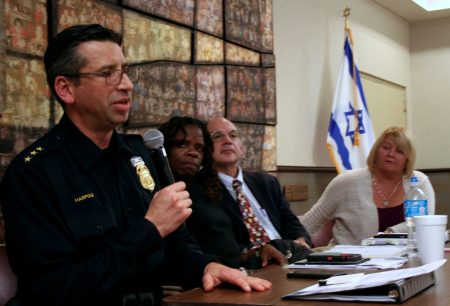 MPD Assistant Police Chief James Harpole (left) speaks briefly during the panel discussion, as Iris Roley, Al Gerhardstein and Kathy Harrell, all from Cincinnati, look on. Photo by Jabril Faraj.